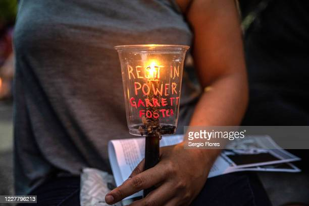 An attendee holds a candle at a vigil for Garrett Foster on July 26, 2020 in downtown Austin, Texas. Garrett Foster who was armed and participating...