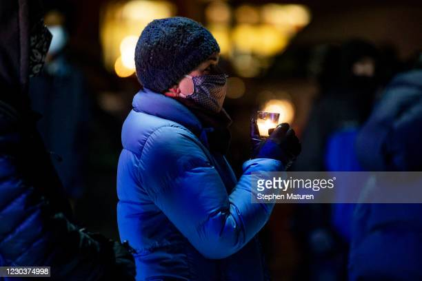 An attendee holds a candle during a vigil for Dolal Idd, who was shot and killed by Minneapolis Police last night, on December 31, 2020 in...