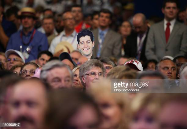 An attendee holds a cutout of Republican vice presidential candidate US Rep Paul Ryan during the third day of the Republican National Convention at...