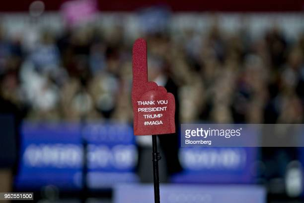 An attendee holds a foam finger reading Thank You President Trump in the air as US President Donald Trump not pictured speaks during a rally in...