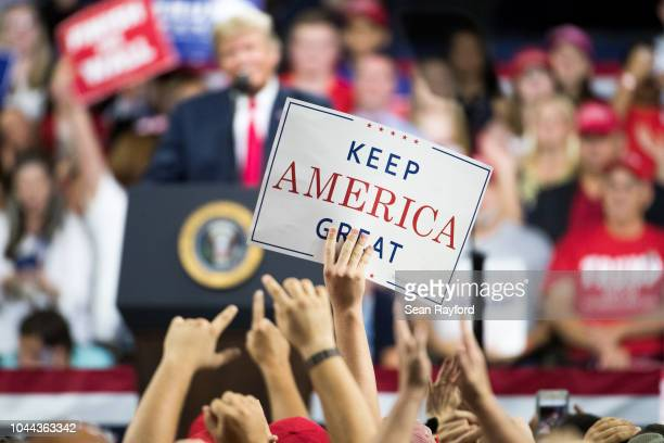 """An attendee holds a """"Keep America Great"""" sign as President Donald Trump speaks to the crowd during a campaign rally at Freedom Hall on October 1,..."""
