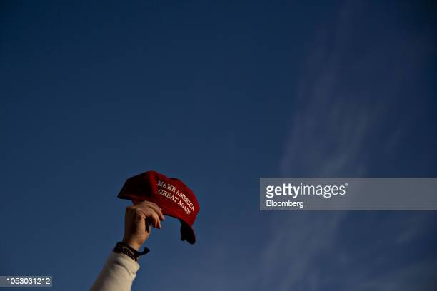 An attendee holds a Make America Great Again hat at the start of a campaign rally with US President Donald Trump and Leah Vukmir a Republican Senate...
