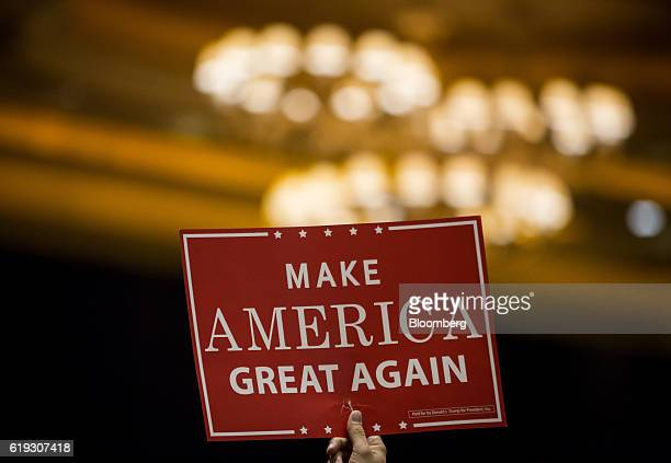 An attendee holds a 'Make America Great Again' sign during a campaign rally for Donald Trump 2016 Republican presidential nominee at the Venetian...