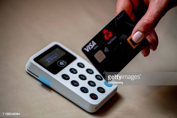 An attendee holds a new biometric bank debit card during the launch of National Westminster Bank Plc's biometric debit card in this arranged...