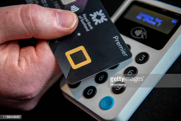 An attendee holds a new biometric bank debit card during the launch of Royal Bank of Scotland Group Plc's biometric debit card in this arranged...