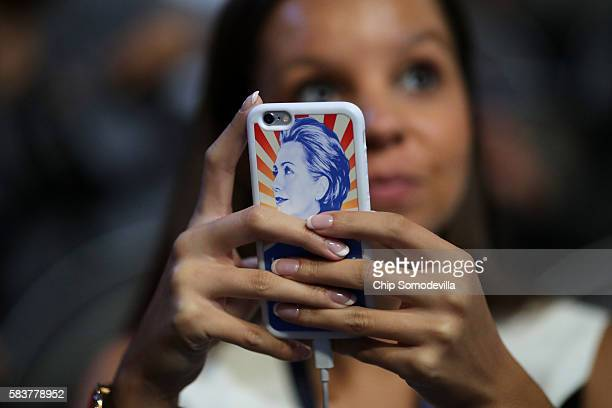 An attendee holds a phone with a Hillary Clinton themed case on the third day of the Democratic National Convention at the Wells Fargo Center July 27...