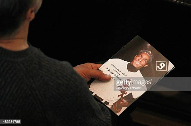 An attendee holds a program for the funeral for Chicago White Sox legend Minnie Minoso at Holy Family Church on Saturday, March 7 in Chicago.