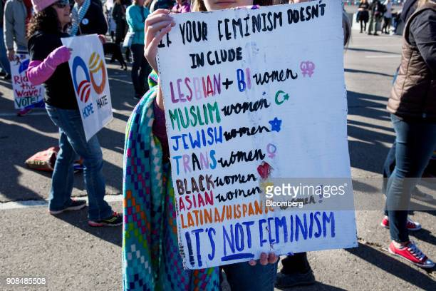 An attendee holds a sign before entering the Sam Boyd Stadium during the Women's March OneYear Anniversary Power To The Polls event in Las Vegas...
