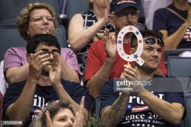 An attendee holds a sign of the letter Q before the start of a rally with US President Donald Trump in WilkesBarre Pennsylvania US on Thursday Aug 2...