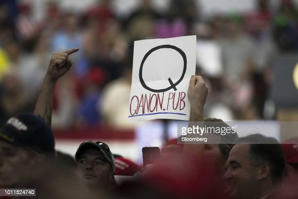 An attendee holds a sign referencing QAnon before the start of a rally with US President Donald Trump in Lewis Center Ohio US on Saturday Aug 4 2018...