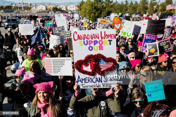 An attendee holds a sign that reads 'Canadian Women Support Our American Sisters' before entering the Sam Boyd Stadium during the Women's March...