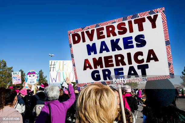 An attendee holds a sign that reads 'Diversity Makes America Great' before entering the Sam Boyd Stadium during the Women's March OneYear Anniversary...