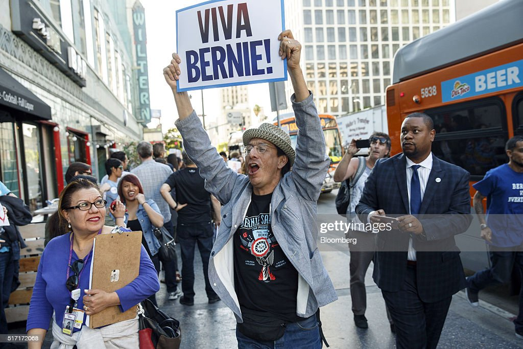 An attendee holds a 'Viva Bernie!' sign outside a campaign event for Senator Bernie Sanders, an independent from Vermont and 2016 Democratic presidential candidate, not pictured, in Los Angeles, California, U.S., on Wednesday, March 23, 2016. Sanders won the Democratic caucuses in Utah, according to the Associated Press, while votes were still being counted in the state's Republican caucuses and the Democratic caucuses in Idaho. Photographer: Patrick T. Fallon/Bloomberg via Getty Images