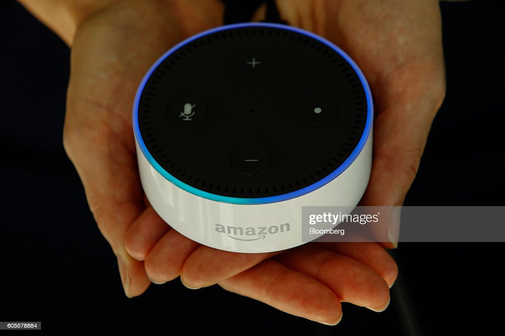 An attendee holds an 'Echo Dot' device during the U.K. launch event for the Amazon.com Inc. Echo voice-controlled home assistant speaker in this arranged photograph in London, U.K., on Wednesday, Sept. 14, 2016. The Seattle-based company today announced that its Echo product line will be available in the U.K. and Germany starting in the fall, the first time the gadget will be available outside the U.S. Photographer: Luke MacGregor/Bloomberg via Getty Images
