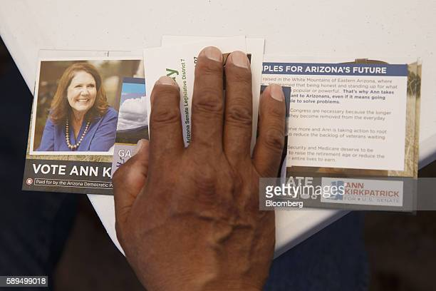 An attendee holds campaign literature during an event for Representative Ann Kirkpatrick a Democrat from Arizona not pictured on the Navajo Nation...