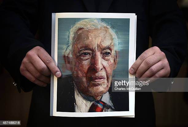 An attendee holds the order of service which features a portrait of the late Lord Bannside as guests arrive for the Ian Paisley memorial service at...