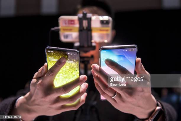 An attendee holds the Samsung Electronics Co Galaxy S10 left and the Galaxy S10 during the Samsung Unpacked launch event in San Francisco California...