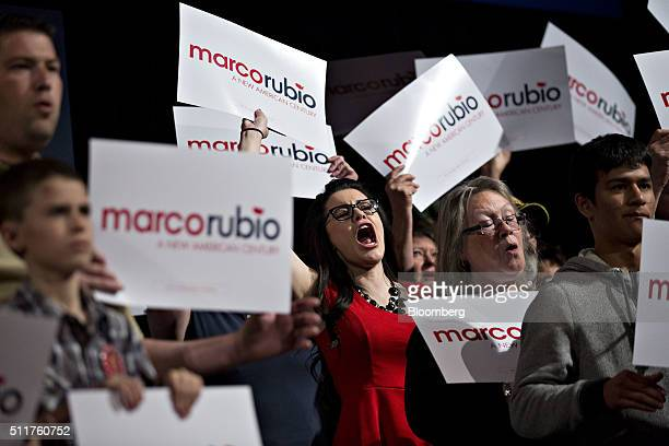 An attendee holds up a campaign sign and cheers as Senator Marco Rubio a Republican from Florida and 2016 presidential candidate not pictured speaks...