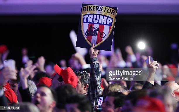 An attendee holds up a sign in support of Republican presidential nominee Donald Trump that reads Bikers For Trump during the election night event at...