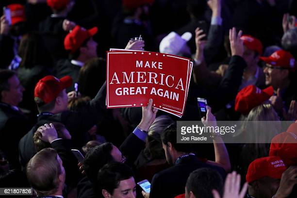 An attendee holds up a sign in support of Republican presidential nominee Donald Trump that reads 'Make America Great Again' during the election...