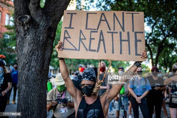 An attendee holds up a sign that reads I Can't Breathe at a vigil for Garrett Foster on July 26 2020 in downtown Austin Texas Garrett Foster who was...