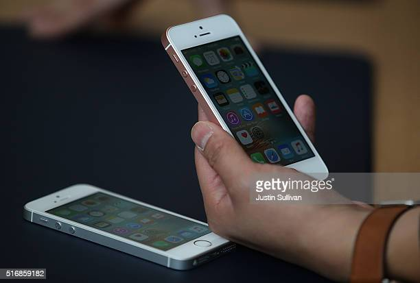 An attendee inpsects the new iPhone SE during an Apple special event at the Apple headquarters on March 21 2016 in Cupertino California Apple...