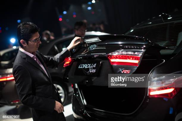 An attendee inspects the boot of a new2018 Toyota Motor Corp. Corolla vehicle during the company's launch event in Sao Paulo, Brazil, on Thursday,...