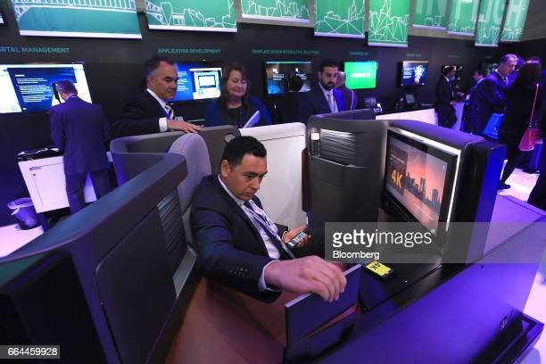 An attendee inspects the first class seating unit and 4K digital screen on display in the Panasonic Avionics Corp. Pavilion at the 2017 Aircraft...