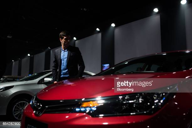 An attendee inspects the new2018 Toyota Motor Corp. Corolla vehicle during the company's launch event in Sao Paulo, Brazil, on Thursday, March 16,...