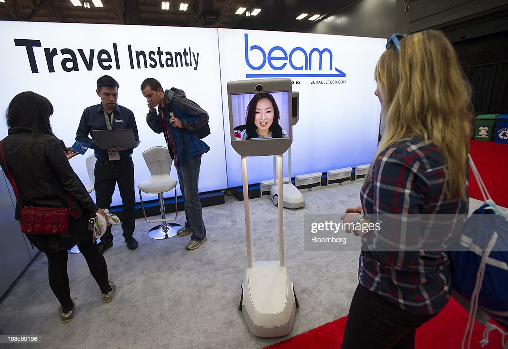 An attendee interacts with an employee using Beam, a remote presence system made by Suitable Technologies, at the South By Southwest Conference (SXSW) in Austin, Texas, U.S., on Monday, March 11, 2013. The 20th annual SXSW Interactive Festival takes place from March 8-12. Photographer: David Paul Morris/Bloomberg via Getty Images