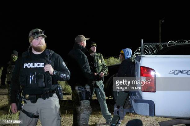 An attendee is detained then released after briefly physically crossing a security line as attendees gathered to storm Area 51 at an entrance to the...