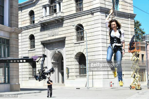 An attendee is filmed ziplining at the F9 Fest event on the Universal Studios backlot celebrating F9: The Fast Saga on September 15, 2021 in...