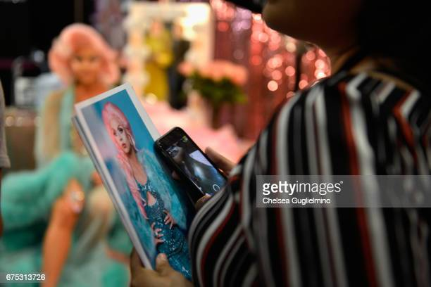 An attendee is seen at Farrah Moan's booth during 3rd Annual RuPaul's DragCon day 2 at Los Angeles Convention Center on April 30 2017 in Los Angeles...