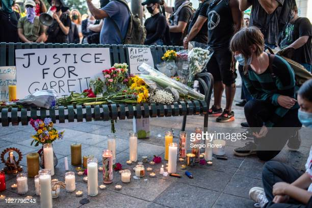 An attendee kneels at a memorial at a vigil for Garrett Foster on July 26, 2020 in downtown Austin, Texas. Garrett Foster who was armed and...