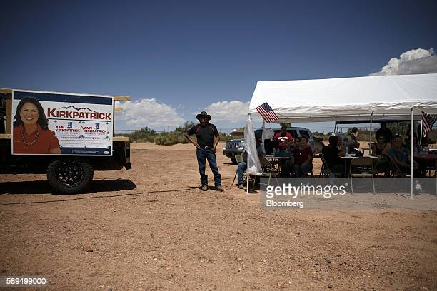 An attendee listens as Representative Ann Kirkpatrick a Democrat from Arizona not pictured speaks during a campaign event on the Navajo Nation Native...