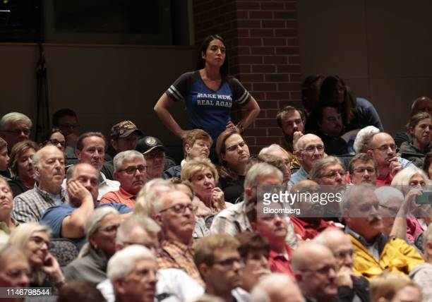 An attendee listens as Representative Justin Amash, a Republican from Michigan, not pictured, responds to a question during a town hall event in...