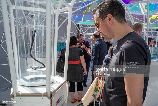 An attendee looks at a bluetooth stethoscope manufactured by 3M Co during the South By Southwest Interactive Festival in Austin Texas US on Saturday...