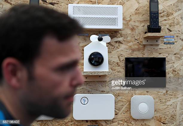 An attendee looks at a display of Nest products during Google I/O 2016 at Shoreline Amphitheatre on May 19 2016 in Mountain View California Google...
