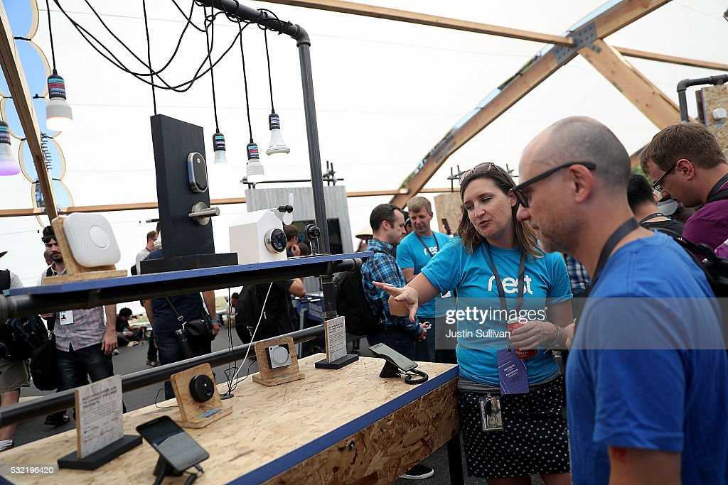 An attendee looks at a display of Nest products during Google I/O 2016 at Shoreline Amphitheatre on May 19, 2016 in Mountain View, California. Google CEO Sundar Pichai delivered the keynote address to kick off the annual Google I/O conference that runs through May 20.