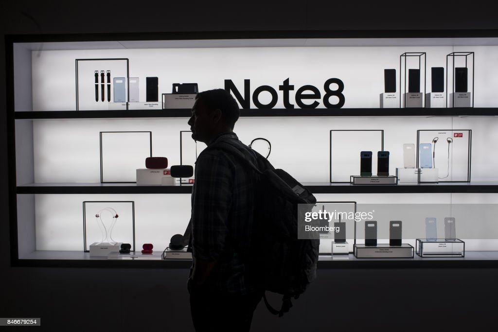An attendee looks at a display of Samsung Electronics Co. Galaxy Note 8 smartphones and accessories during the Mobile World Conference Americas event in San Francisco, California, U.S., on Wednesday, Sept. 13, 2017. Leaders from the mobile ecosystem will be presenting the challenges and opportunities in the industry and the impact it has on society. Photographer: David Paul Morris/Bloomberg via Getty Images