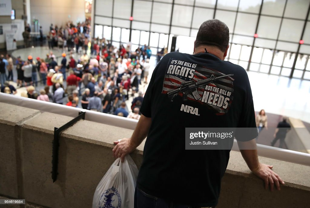 An attendee looks at a line to enter the NRA-ILA Leadership Forum during the NRA Annual Meeting & Exhibits at the Kay Bailey Hutchison Convention Center on May 4, 2018 in Dallas, Texas. The National Rifle Association's annual meeting and exhibit runs through Sunday.