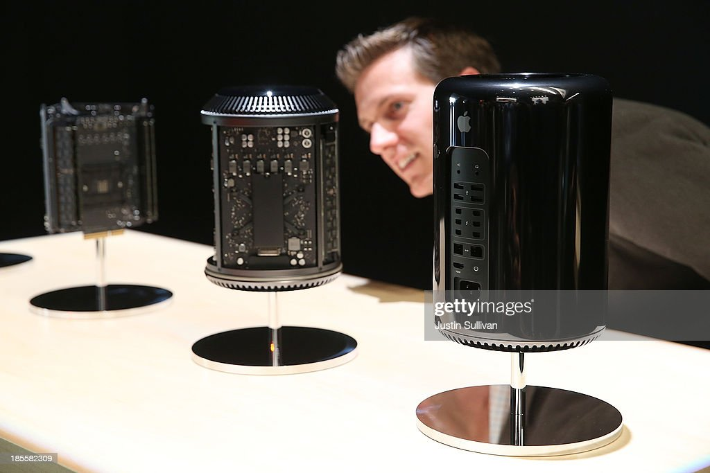 An attendee looks at the new Mac Pro during an Apple announcement at the Yerba Buena Center for the Arts on October 22, 2013 in San Francisco, California. The tech giant announced its new iPad Air, a new iPad mini with Retina display, OS X Mavericks and highlighted its Mac Pro.