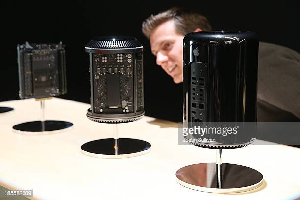 An attendee looks at the new Mac Pro during an Apple announcement at the Yerba Buena Center for the Arts on October 22, 2013 in San Francisco,...