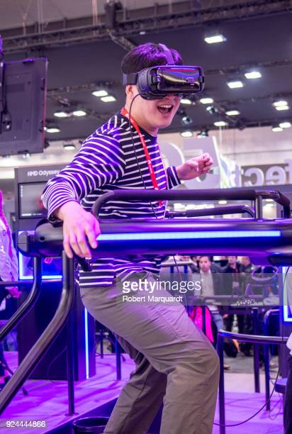 An attendee of Mobile World Congress 2018 is seen enjoying a Samsung VR 4D experience on February 26 2018 in Barcelona Spain Mobile World Congress...