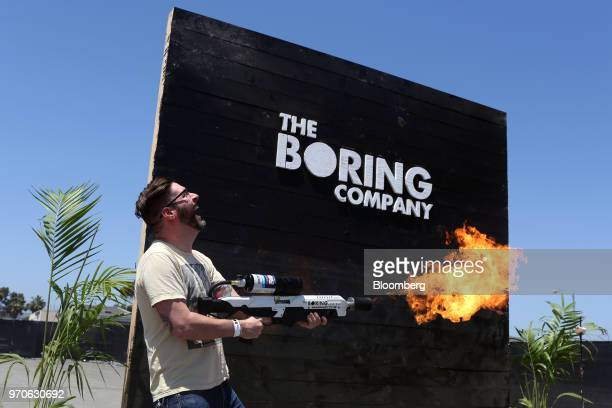 An attendee operates a Boring Co. Flamethrower during the company's Not-a-Flamethrower Party outside of the Space Exploration Technologies Corp....