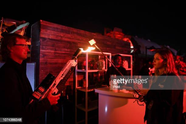 An attendee operates a Boring Co. Flamethrower to toast a marshmallow during an unveiling event for The Boring Company Hawthorne test tunnel December...