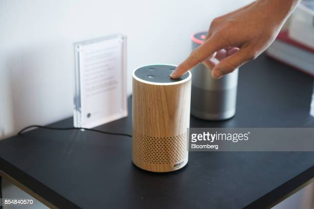 An attendee operates the new Amazoncom Inc Echo device on display during the company's product reveal launch event in downtown Seattle Washington US...