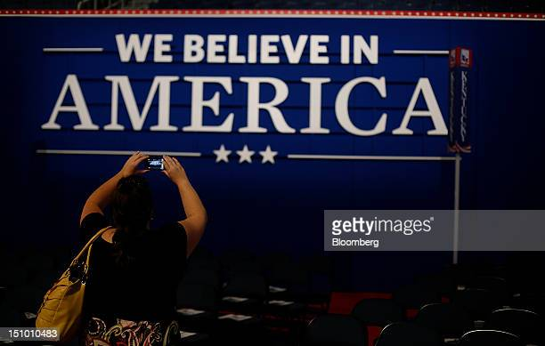 An attendee photographs a sign at the Republican National Convention in Tampa Florida US on Thursday Aug 30 2012 Republican presidential nominee Mitt...