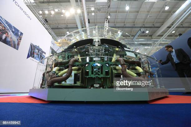 An attendee photographs at an aircraft cockpit section with an interior manufactured by Hutchinson Composite Industrie at the 2017 Aircraft Interiors...