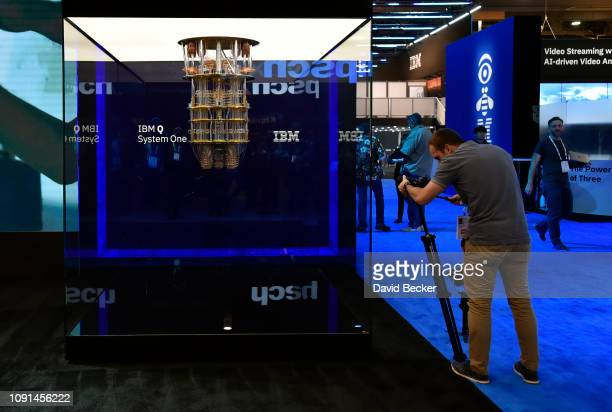 An attendee photographs IBM's Q System One display at the IBM booth at CES 2019 at the Las Vegas Convention Center on January 8 2019 in Las Vegas...